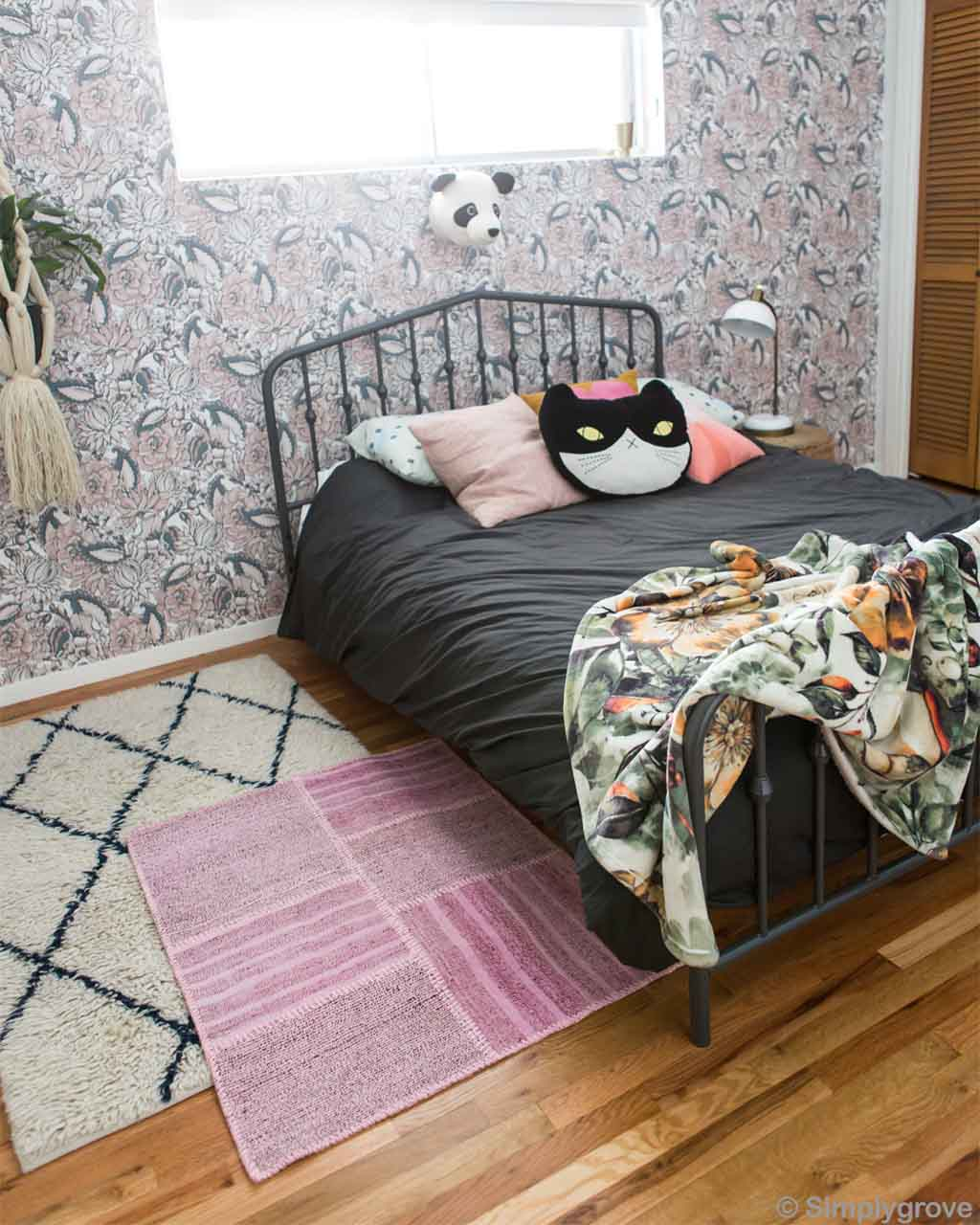 cat faced pillow on bed morocco traditional carpet