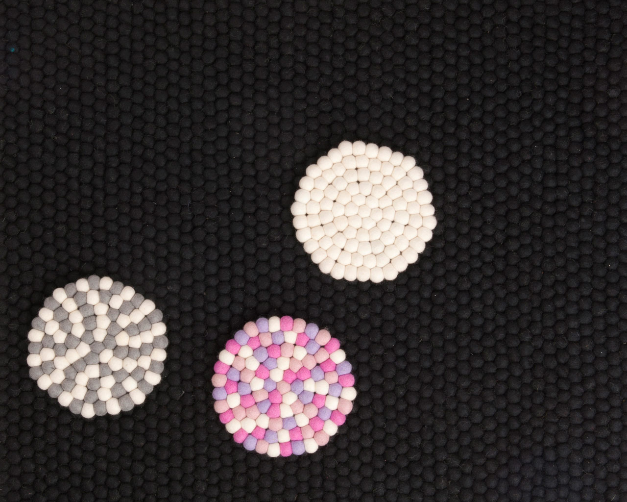 black carpet coasters colourful wool