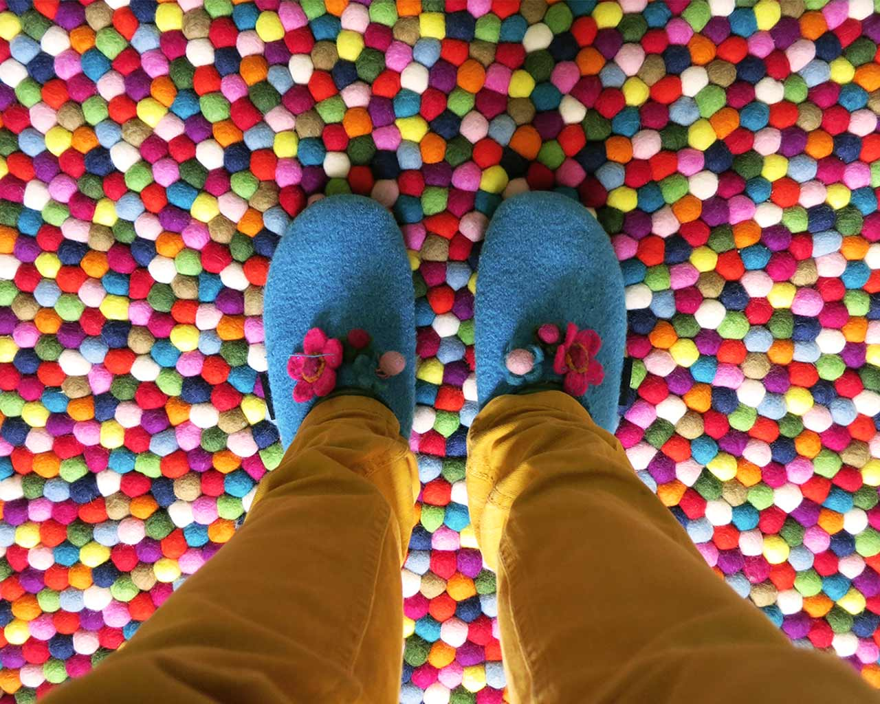 blue slippers pinocchio felt balls carpet